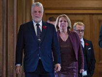 Quebec Premier Philippe Couillard, left, and Christine St-Pierre,