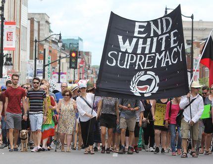 The Kingston Anti-fascist Solidarity Memorial Parade walks against traffic on Princess Street in Kingston, Ont. on Saturday August 19, 2017. Steph Crosier/Kingston Whig-Standard/Postmedia Network
