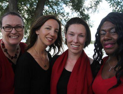 From left, Nicole Szumlanski, Julie Plaza, Rachel Burnett and Teaisha Whittingham of the Kingston Canadian Military Wives Choir on Saturday. (Steph Crosier/The Whig-Standard)