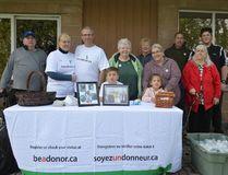 Friends and family supported the Tinneys as they raised awareness for organ donation at Gillies Lake on Saturday. From left: Doug Merritt, Leslie Tinney, Greg Tinney, Ethyn Laroche, Carol Jones, Frances Burke, Emily Laroche, Marnie Bilodeau, Ron Bilodeau, Linda Merritt, Adam Tinney