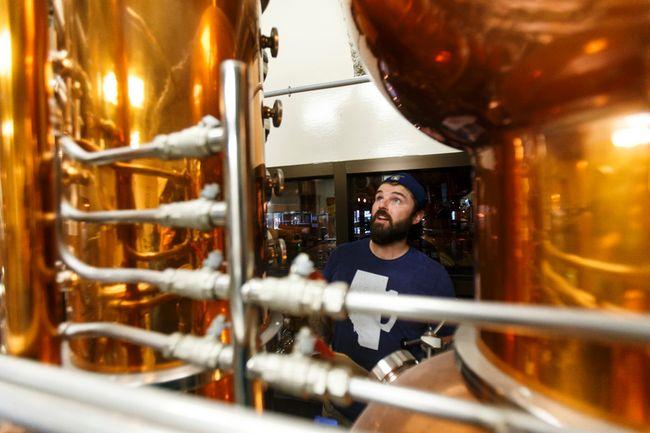 Head brewer Spike Baker checks his still at the Wood Buffalo Brewing Company in Fort McMurray, Alta., on Thursday, June 9, 2016. Ian Kucerak/Postmedia Network