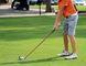 Carson Inman teeing off at Portage Golf Club.