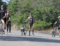 Triathletes Aiden MacKenzie, Bella Mastroianni , Ian MacKenzie and Lexine Moyle practise their dismounts at Delki Dozzi Cycling Track in Sudbury, Ont. Gino Donato/Sudbury Star/Postmedia Network