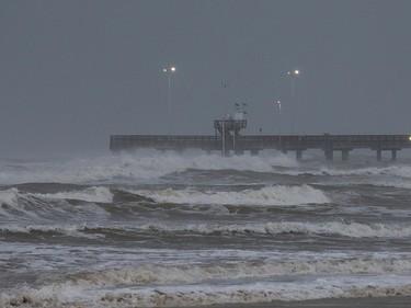 Surf rises at Bob Hall Pier Corpus Christi, Texas, as Hurricane Harvey approaches on Friday, Aug. 25, 2017. (Courtney Sacco/Corpus Christi Caller-Times via AP)