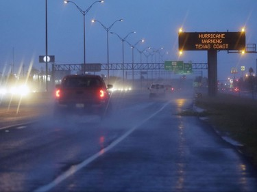 Motorists pass a warning sign  as Hurricane Harvey approaches the Gulf Coast area Friday, Aug. 25, 2017, in Corpus Christi, Texas. (AP Photo/Eric Gay)