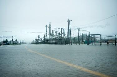 A view of the Marathon Texas City Refinery as rain from Hurricane Harvey floods a road on Aug. 26, 2017 in Galveston, Texas. (BRENDAN SMIALOWSKI/AFP/Getty Images)