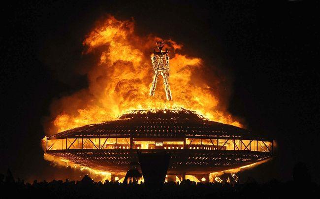 "In this Aug. 31, 2013, file photo, the ""Man"" burns on the Black Rock Desert at Burning Man near Gerlach, Nev. (Andy Barron/Reno Gazette-Journal, File via AP)"