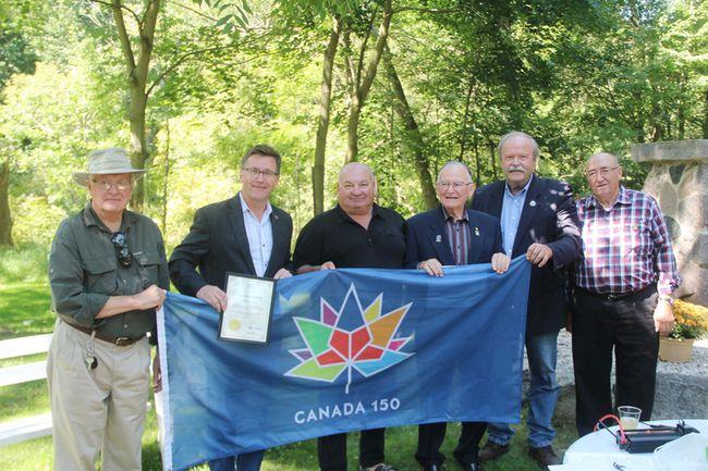 Clarke Birchard, Bruce-Grey-Owen Sound MPP Bill Walker, Bruce-Grey-Owen Sound MP, Larry Miller who presented a Canada 150 flag, Ron Oswald, Arran-Elderslie Mayor Paul Eagleson, and Arran-Elderslie Councillor Doug Bell.