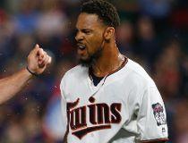 Minnesota Twins' Chris Gimenez, left, celebrates with Byron Buxton