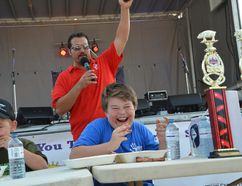 Kids rib-eating competition champion Phoenix Leeson at Owen Sound Ribfest on Saturday. (Scott Dunn/The Owen Sound Sun Times/Postmedia Network)