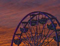A setting sun sets the sky ablaze behind Ferris Wheel at the Western Fair in London. (DEREK RUTTAN, The London Free Press)
