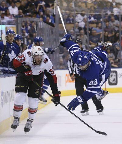 Toronto Maple Leafs center Nazem Kadri (43) is flipped up into the air after battling for the puck against Ottawa Senators defenseman Fredrik Claesson (33) in Toronto on Tuesday September 19, 2017. The Toronto Maple Leafs host the Ottawa Senators at the ACC. Veronica Henri/Toronto Sun/Postmedia Network