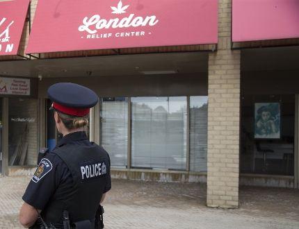 Police arrested five people in a raid on London's newest marijuana dispensary, London Relief Centre. (DEREK RUTTAN, The London Free Press)