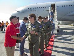Mayor Matt Brown welcomes Sgt. Erin Wallace and 15 other crew members of a Royal Australian Air Force. (DEREK RUTTAN, The London Free Press)