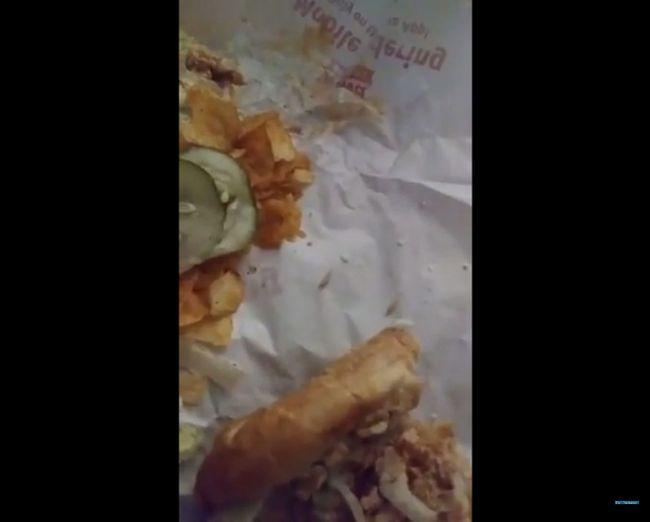 Maggots are seen in the wrapper of buffalo chicken cheesesteak hoagie. (Video screenshot)