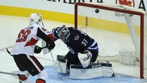 Senators forward Alex Formenton beats Winnipeg Jets goaltender Connor Hellebuyck on a breakaway during a pre-season game in Winnipeg on Wednesday. (Kevin King/Postmedia Network)