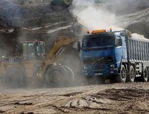 In this Tuesday, Sept. 26, 2017 photo, a bulldozer removes sand at Tel Es-Sakan hill, south of Gaza City. (AP Photo/Adel Hana)