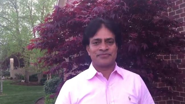 """Dr. Achutha Reddy. (<a href=""""https://www.youtube.com/watch?v=oSfTTAN3Ins"""" target=_blank"""">Achutha Reddy/Absolute Yoga</a> YouTube video screenshot)"""