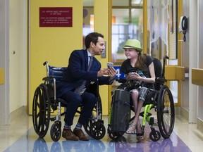 Children's Hospital of Eastern Ontario CEO Alex Munter and leukemia patient Sarah Telford. BRUCE DEACHMAN / POSTMEDIA