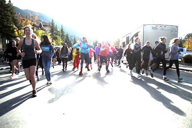 Hannah Macnaughton and Skylar Belczyk roller blade their way through the Banff Community High School Turkey Trot on Friday, Oct. 6, 2017. Russ Ullyot/ Bow Valley Crag & Canyon/ Postmedia Network