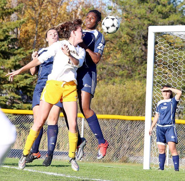 Tiffany Johnson of the Cambrian Golden Shield women's soccer team heads the ball during OCAA action against University of Toronto Mississauga in Sudbury on Tuesday. Gino Donato/Sudbury Star/Postmedia Network