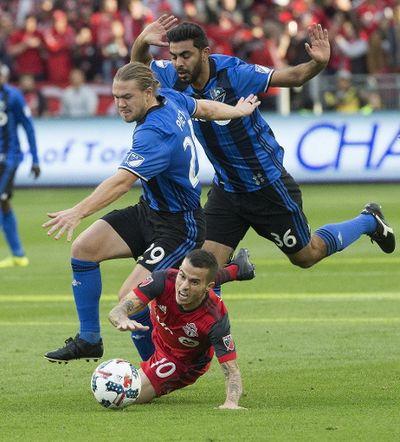 TFC's Sebastian Giovinco gets taken down by the Impact's Samuel Piette during Toronto FC's match on Sunday, Oct. 15, 2017. (Stan Behal, Toronto Sun)
