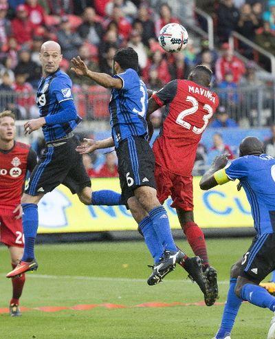Chris Mavinga goes up for the ball during Toronto FC's match on Sunday, Oct. 15, 2017. (Stan Behal, Toronto Sun)