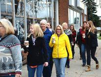 Local women take a walking tour to meet female entrepreneurs through downtown on Oct. 14 (Peter Shokeir | Whitecourt Star).
