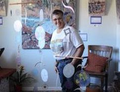 PHOTO SUPPLIED - Local Francophone artist Karen Blanchet stands near her contribution to Devenir, an exhibit which explores the creative process. It runs at CAVA starting Oct. 20.