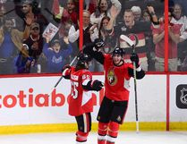 Ottawa Senators right winger Alexandre Burrows (right) celebrates a goal with teammate Erik Karlsson on Oct. 19, 2017. (SEAN KILPATRICK/The Canadian Press)