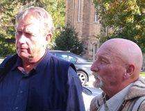 Michael Schmidt, left and John Schnurr outside court in Walkerton Thursday. Don Crosby/For The Sun Times