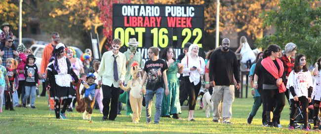 Ninth annual Soo Zombie Walk participants make their way along Bay Street.