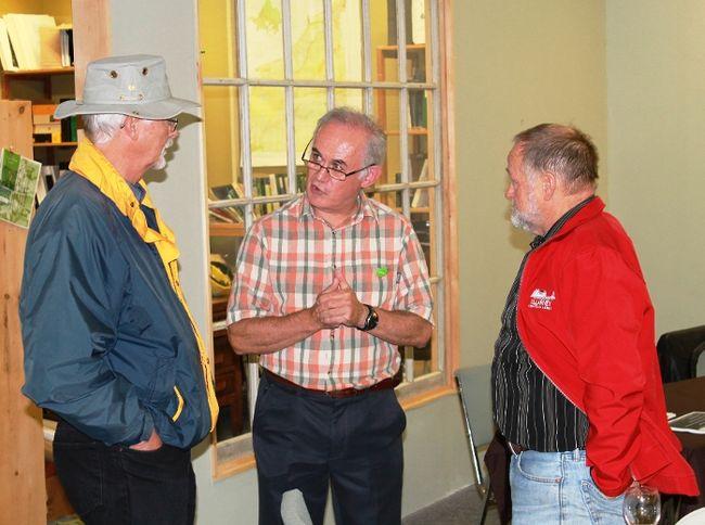 Engineer John Ward speaks to two guests at Green Drinks Sarnia following his presentation on electric cars. CARL HNATYSHYN/SARNIA THIS WEEK