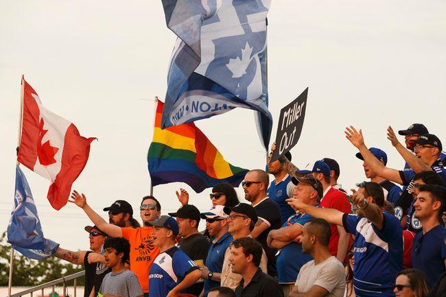 IAN KUCERAK Postmedia Network - Eddies fans cheer during a NASL soccer game between FC Edmonton and North Carolina FC at Clarke Stadium last July.