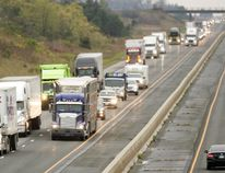 Transport trucks head east on Highway 401 near London. (MIKE HENSEN, The London Free Press)