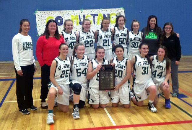St. John's College celebrates winning the high school junior girls basketball championship. (Expositor Staff)