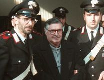 In this Jan. 16, 1996 file photo, Mafia ''boss of bosses'' Salvatore ''Toto'' Riina, center, enters handcuffed into Bologna's bunker-courtroom, escorted by Carabinieri, Italian paramiliary police, in Bologna, Italy. (AP Photo/Gianni Schicchi, File)