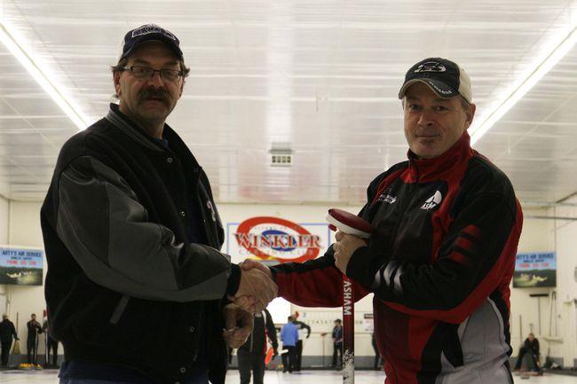 Winkler Curling Club president Brent Haney welcomes Rob Swan to Winkler on Nov. 15 as part of his Curling Across the Nation tour. (LAUREN MACGILL, Winkler Times)