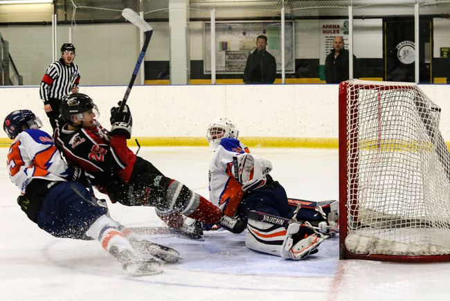Landon Siegle of the Blackfalds Wranglers crashes into High River Flyers goaltender Dylan Jensen after scoring a goal on Sunday at the Blackfalds Multi-plex Arena. (Ashli Barrett/Lacombe Globe)