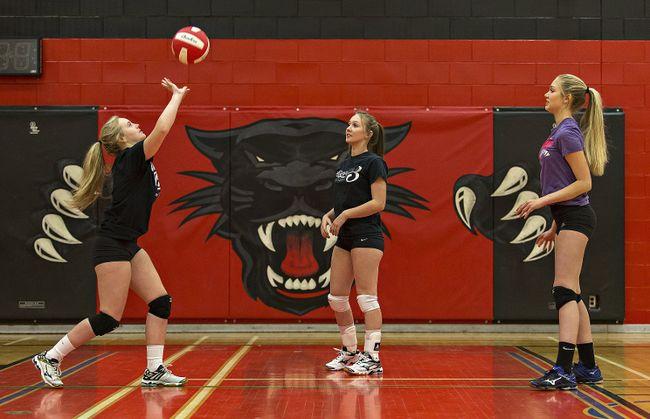 Tori Holland (left), Alexa Clark and Carmen Gillyatt of the Paris District High School senior girls volleyball team practise this week. (Brian Thompson/The Expositor)