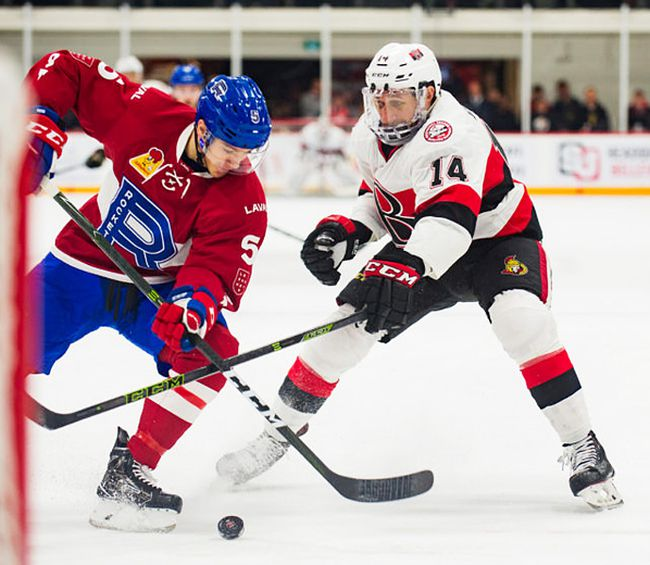 Belleville Senators forward Jim O'Brien ties up Laval Rocket defenceman Tom Parisi during AHL action Wednesday night at Yardmen Arena. (Ottawa Senators photo)