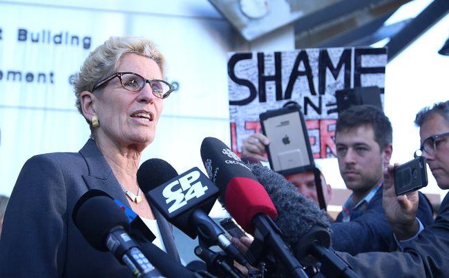 Premier Kathleen Wynne speaks to media at a courthouse in Sudbury, Ont. on Wednesday September 13, 2017. Gino Donato/Sudbury Star/Postmedia Network
