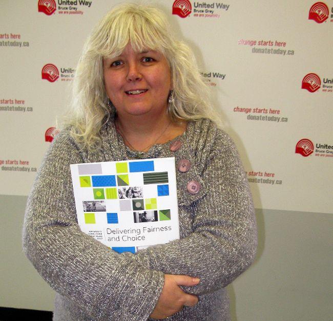 Francesca Dobbyn holds a copy of Ontario's long-term energy plan. DENIS LANGLOIS/THE SUN TIMES