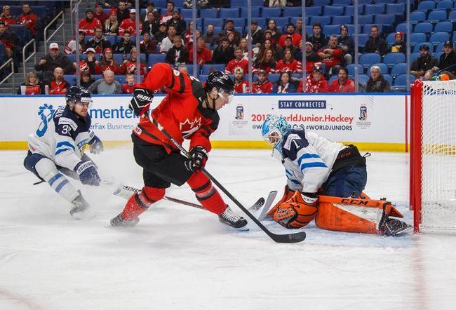 Boris Katchouk scores on Finland's Ukko-Pekka Luukkonen as Kasper Kotkansalo looks on during the first period of IIHF World Junior Championship preliminary round hockey action in Buffalo, N.Y., Tuesday. Mark Blinch / THE CANADIAN PRESS