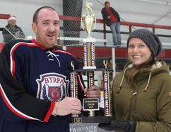 Guns & Hoses captain Michael Payne accepts the trophy from Morden Cheer's Megan Andrews. (GREG VANDERMEULEN/Morden Times)