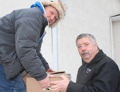 Volunteers load trucks with Christmas hampers for Morden Christmas Cheer. (GREG VANDERMEULEN/Morden Times)