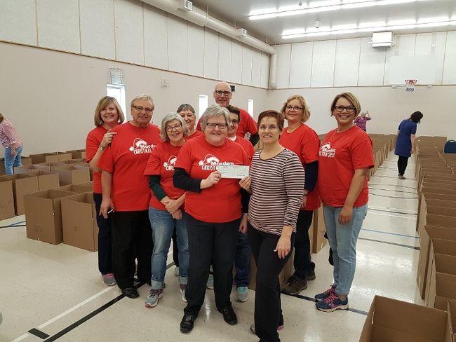 Penner Waste donated $1,000 to Morden Christmas Cheer. (LAUREN MACGILL/Morden Times)