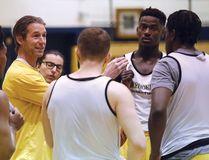 Laurentian Voyageurs men's varsity basketball coach Shawn Swords, second left, talks to his players during practice at Laurentian University in Sudbury, Ont. on Thursday January 4, 2018. John Lappa/Sudbury Star/Postmedia Network