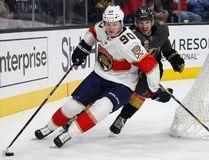 Florida Panthers center Jared McCann (90) skates around Vegas Golden Knights defenseman Shea Theodore during the third period of an NHL hockey game, Sunday, Dec. 17, 2017, in Las Vegas. (AP Photo/John Locher)