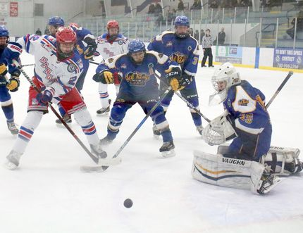 Fort Saskatchewan Bantam AAA Rangers forward Jayden Jolly crashes the net against the Leduc Oil Kings.